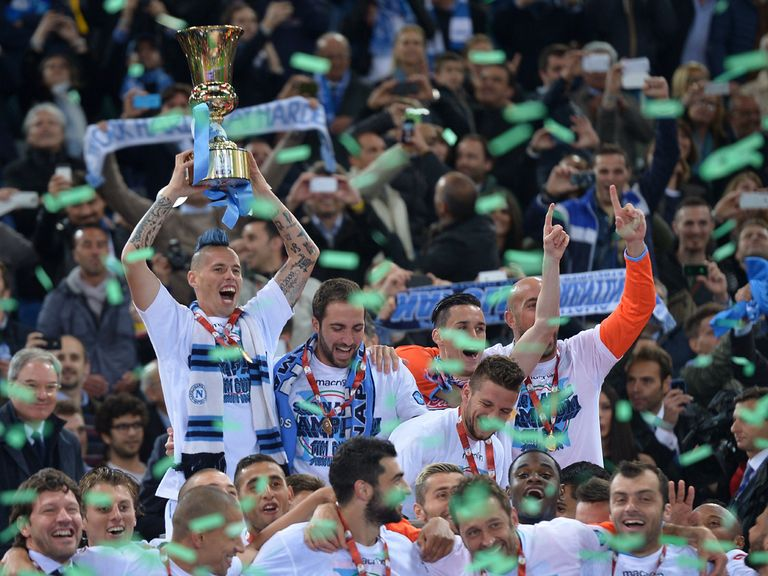 Napoli's Slovakian midfielder Marek Hamsik holds aloft the Coppa Italia