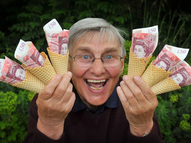 Willie Carson with some money in some ice cream cones as he tries to win the Scoop6 for the Injured Jockeys' Fund... it's all for charity anyway.