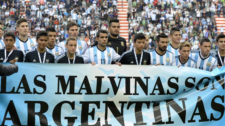 Argentina players stand behind the banner before their friendly win