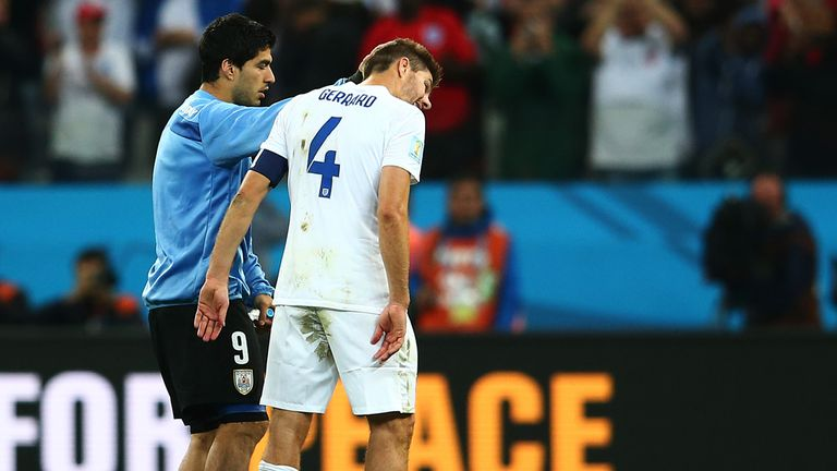 The Liverpool link: Luis Suarez consoles Steven Gerrard after the game