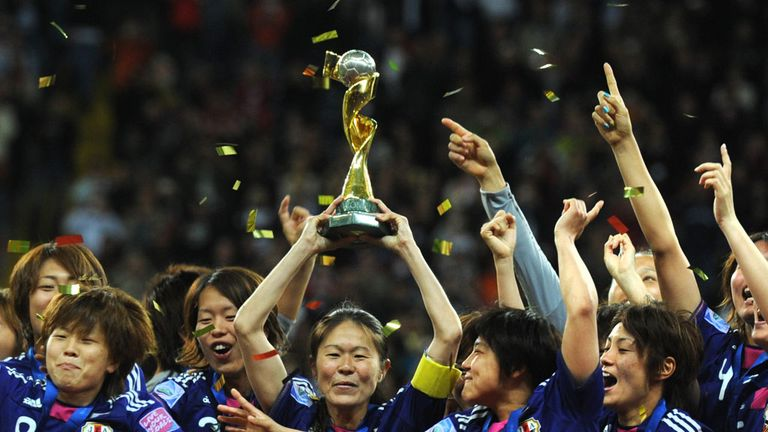 Japan lift the women's World Cup following their penalty shoot-out win over USA in 2011