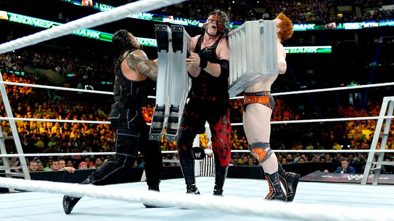 Roman Reigns and Sheamus sandwich Kane during the main-event Ladder Match