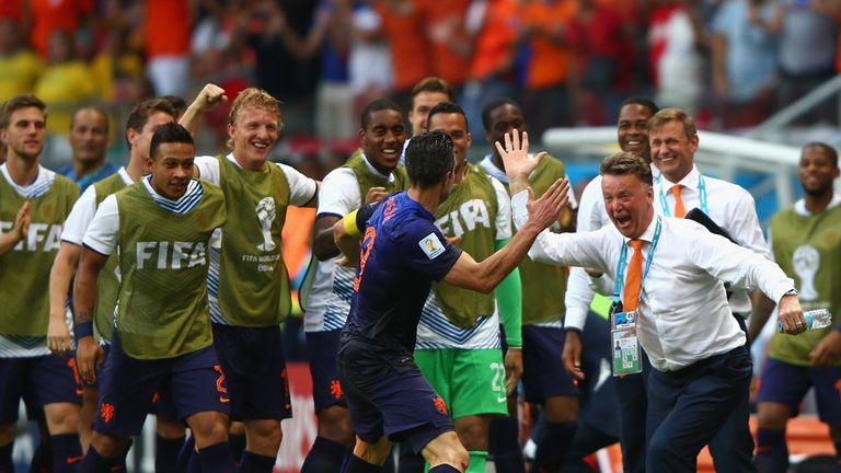 Robin van Persie celebrates with Louis van Gaal