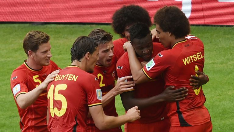 Divock Origi: Mobbed by his Belgium team-mates after stepping off the bench to net the winner