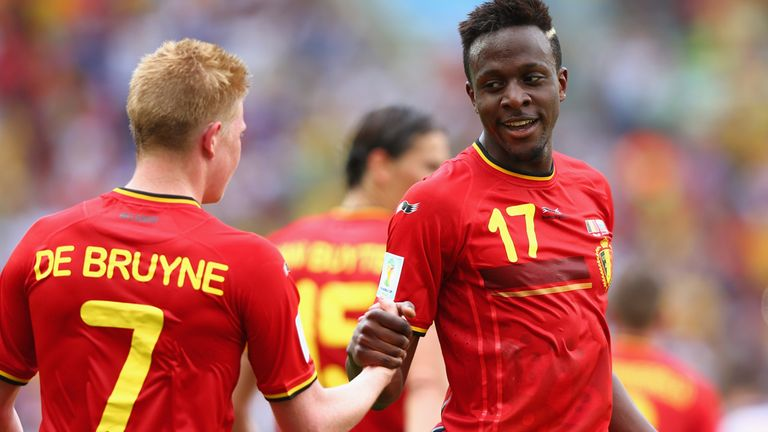 Divock Origi: Celebrates scoring with Kevin De Bruyne
