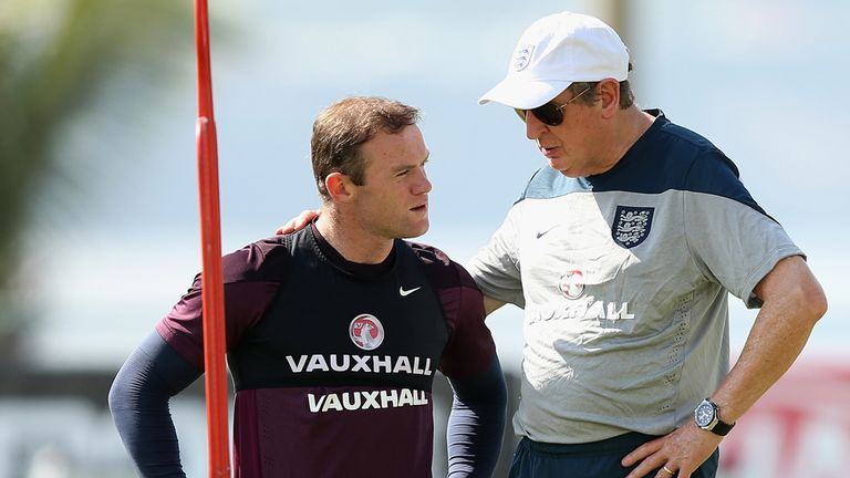 Wayne Rooney: Talks to Roy Hodgson during a training session at the Urca military base