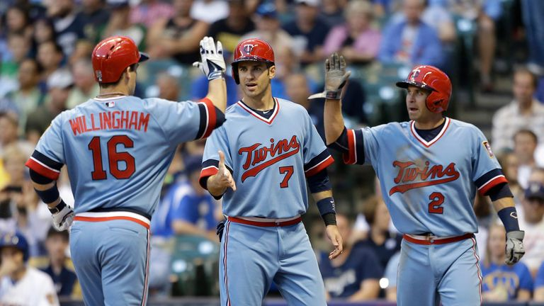 Josh Willingham is congratulated by Joe Mauer and Brian Dozier