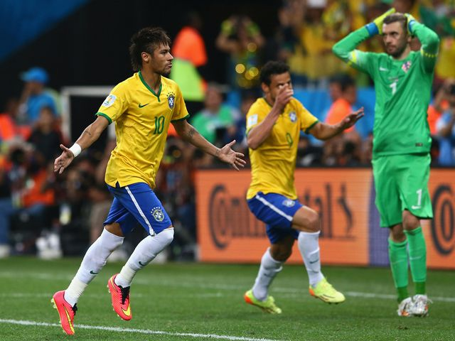 Neymar celebrates his second goal of the match