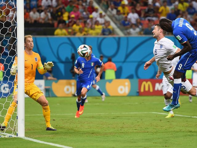 Mario Balotelli heads home the winner for Italy