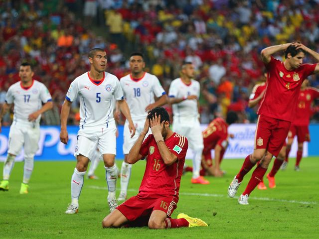 Spain midfielder Sergio Busquets reacts after he misses a great chance