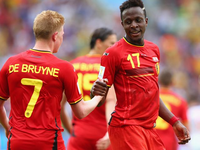 Divock Origi (right) was the hero as Belgium booked their place in the last 16