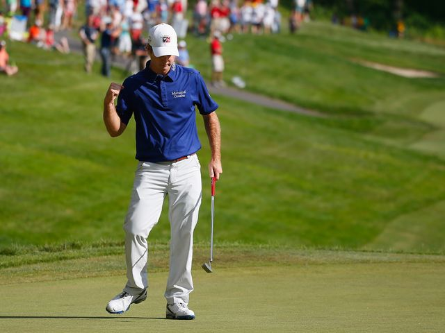 Kevin Streelman celebrates his seventh straight birdie on the 18th