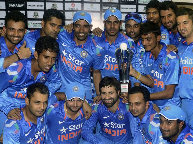 Indian cricketers pose with the trophy at the awards ceremony