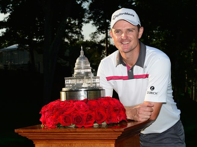 Justin Rose with the Quicken Loans National trophy