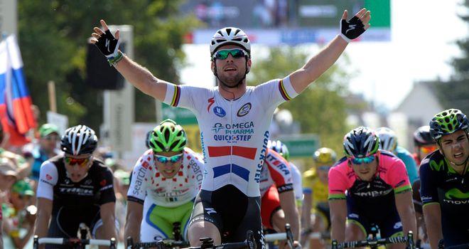 Mark Cavendish celebrates his victory in the British champion's jersey