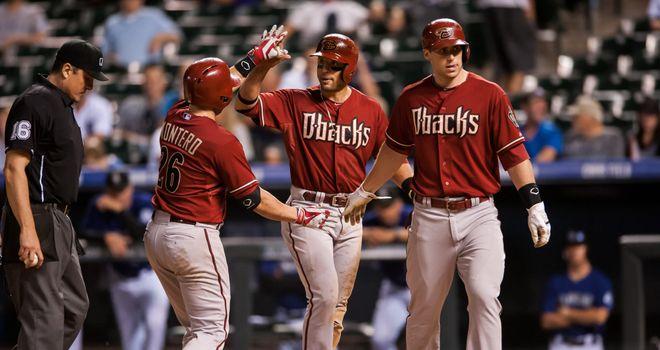 Miguel Montero celebrates a three-run home run with Martin Prado and Paul Goldschmidt
