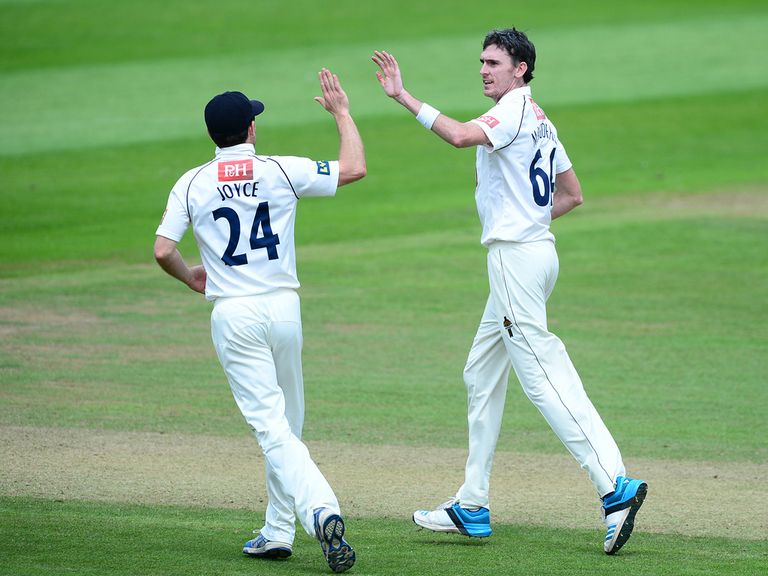 Steve Magoffin of Sussex (right) celebrates with Ed Joyce after taking the wicket of Peter Trego
