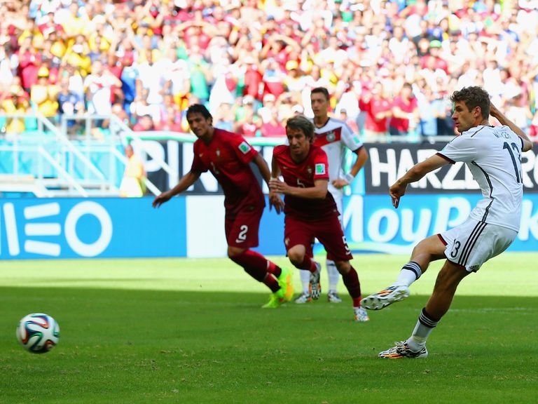 Thomas Muller scores his first goal against Portugal from the spot
