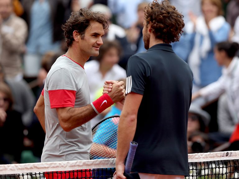 Roger Federer shakes hands with Ernests Gulbis after the latter's win in Paris