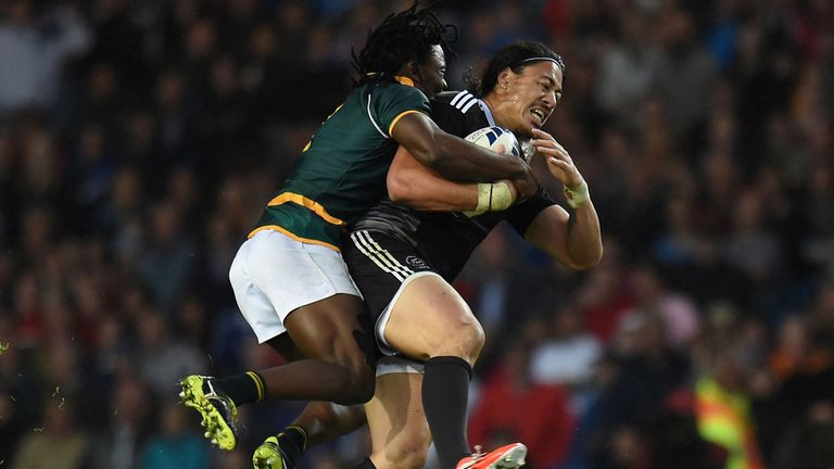 South Africa's Seabelo Senatla (left) tackles New Zealand's Ben Lam (right)
