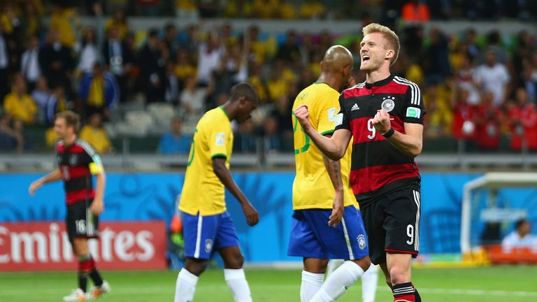 Andre Schurrle celebrates as Germany's goals keep flooding in