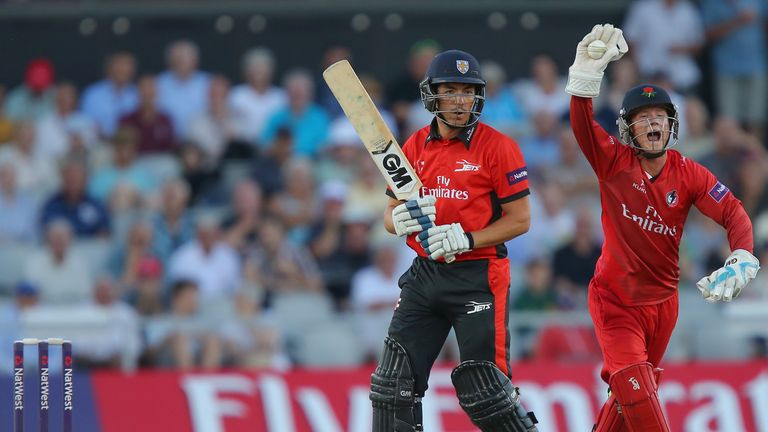 Alex Davies of Lancashire Lightning celebrates the wicket of Michael Richardson of Durham Jets