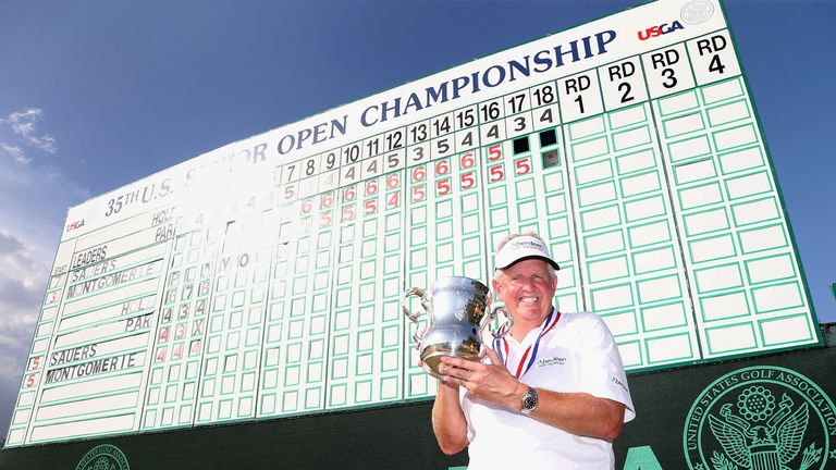 Colin Montgomerie poses with the winner's trophy after winning the 2014 US Senior Open Championship in the final round