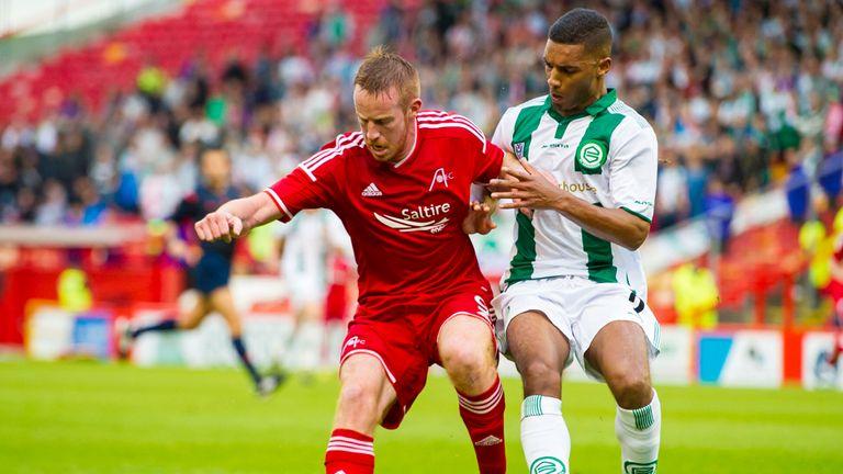 Aberdeen's Adam Rooney (left) in action against Gronigen at Pittodrie