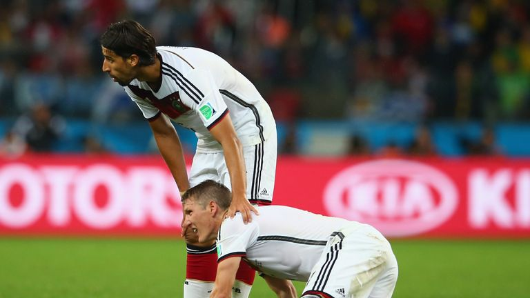 Midfield muddle: Bastian Schweinsteiger and Sami Khedira both believe they're the key for Germany