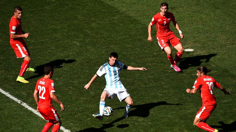 Lionel Messi is surrounded by four Switzerland players as he controls the ball