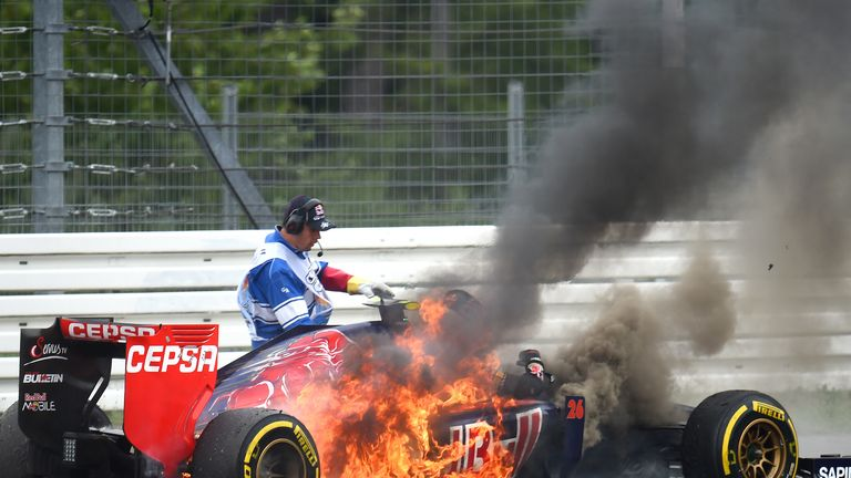 Daniil Kvyat's car bursts into flames