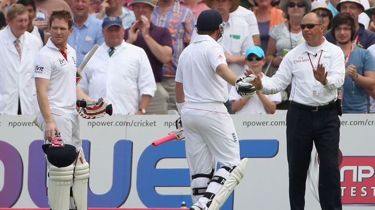 Ian Bell (centre) remonstrates with third umpire Tim Robinson as Eoin Morgan takes in the run out saga