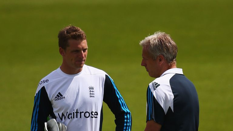 Jos Buttler talks to England coach Peter Moores