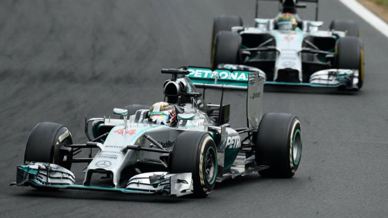 Lewis Hamilton and Nico Rosberg battle in the Hungarian GP