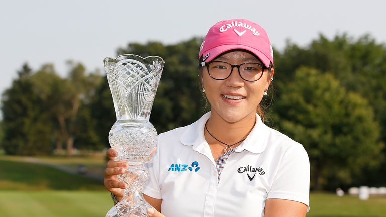 Lydia Ko poses with the trophy after winning the Marathon Classic