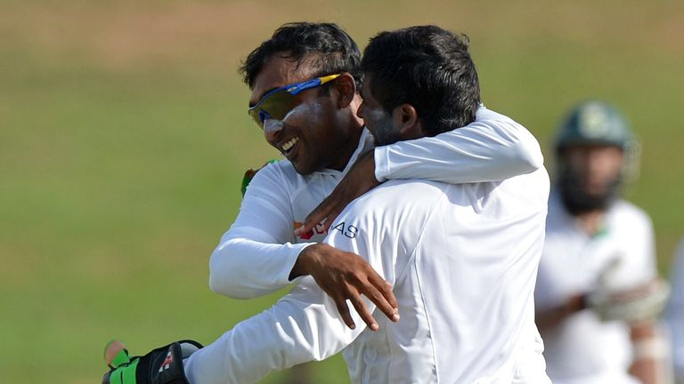 Mahela Jayawardene (L) and Niroshan Dickwella (R): Celebrate the dismissal of Faf du Plessis