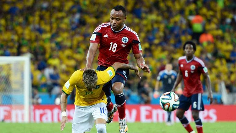 Neymar is challenged by Juan Zuniga