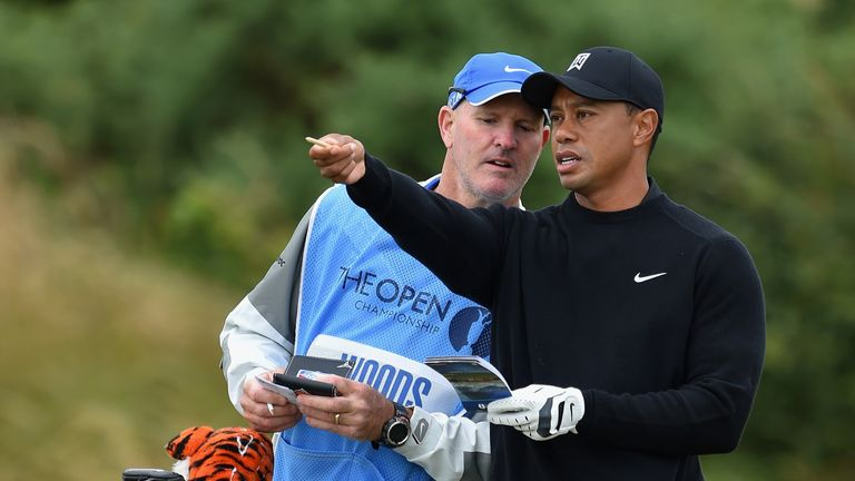 Tiger Woods chats with his caddie Joe LaCava during a practice round prior to the start of The 143rd Open