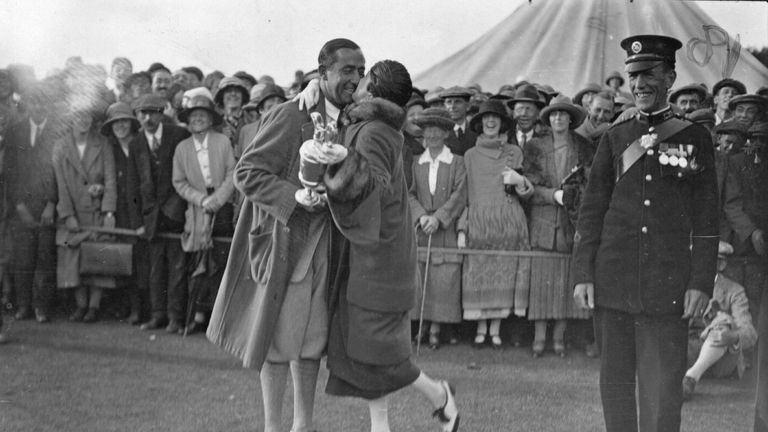 Walter Hagen being congratulated by his wife at Hoylake