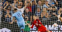 Aleksandar Kolarov of Manchester City scores a penalty in the win over Kansas