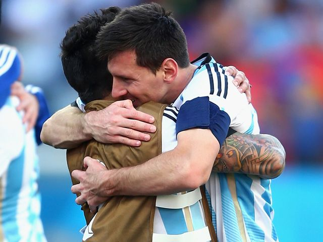 Lionel Messi celebrates with Ezequiel Lavezzi