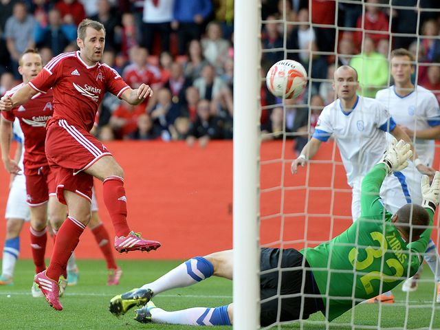 Niall McGinn scores Aberdeen's second goal against FK Daugava Riga