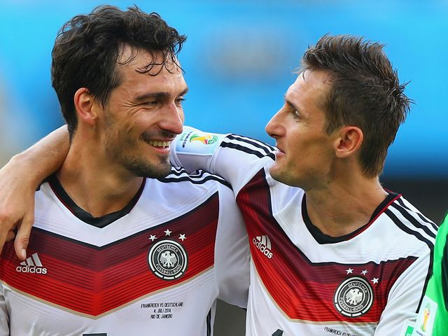 Mats Hummels (left) and Miroslav Klose celebrate after making it to the World Cup semi-finals
