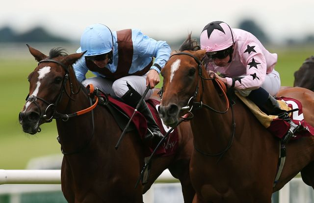 Mango Diva, ridden by Ryan Moore (right), on her way to winning the Kilboy Estate Stakes.