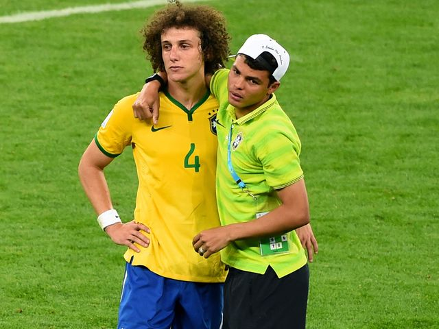 Thiago Silva  tries to console David Luiz after the game