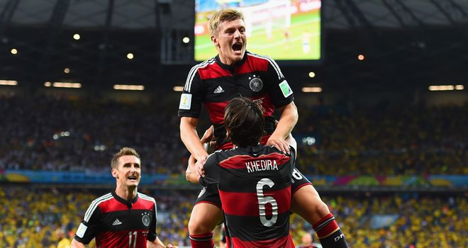 Toni Kroos: Celebrates with Sami Khedira after scoring in Germany's demolition of Brazil