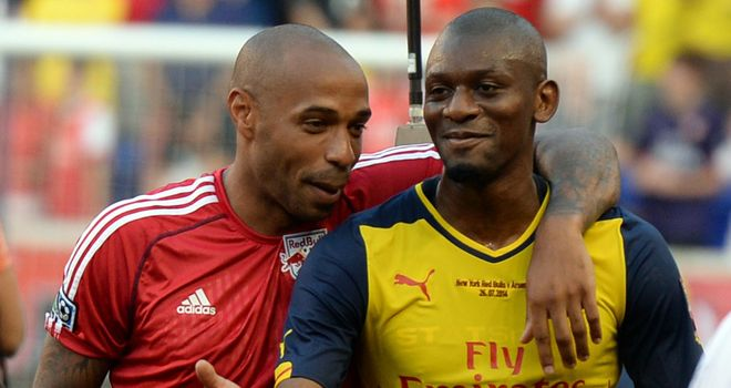 Thierry Henry: Pictured with Abou Diaby after the game