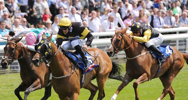 Ladies Are Forever sports a natty line in blinkers as she holds off Joyeuse to score at York again.