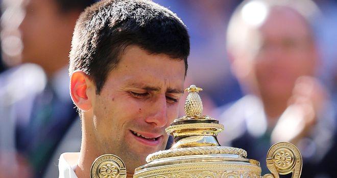 Novak Djokovic weeps whilst holding the Wimbledon trophy