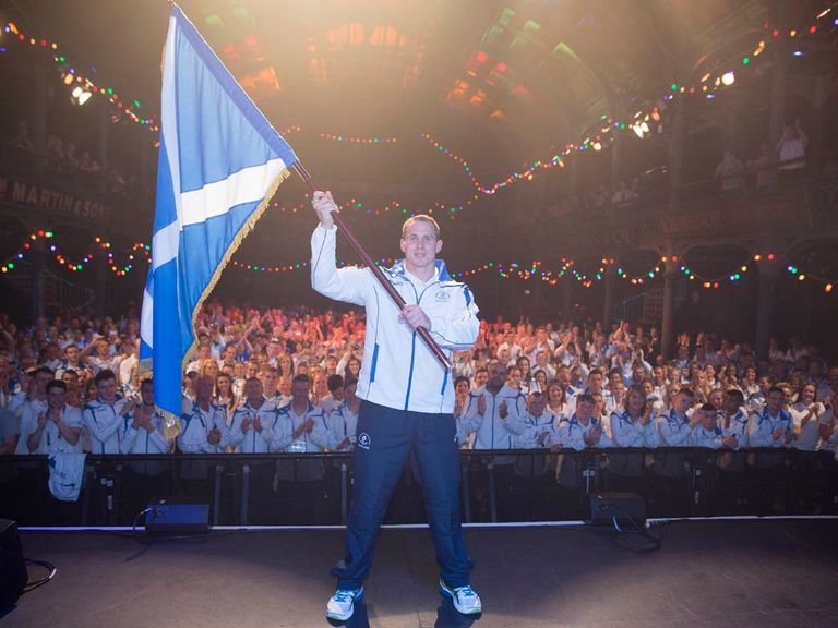 Euan Burton proudly displays the Scottish flag